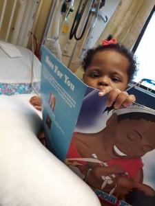 Kaelle reading her book