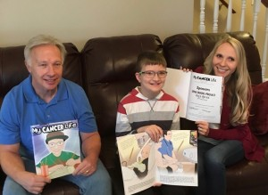 Author, illustrator and Matthew with book copies.